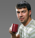 young handsome brunet holding a cup of something, smiling poster