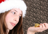 Brunette Teenager wearing a fluffy christmas hat poster