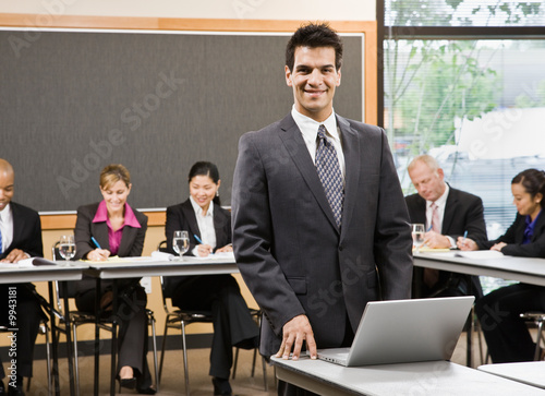 Businessman preparing for presentation on laptop