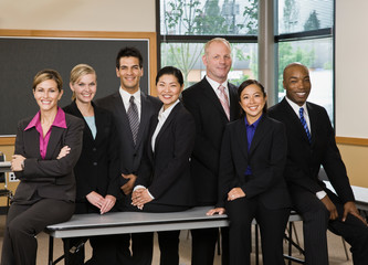 Multi-ethnic co-workers posing in conference room