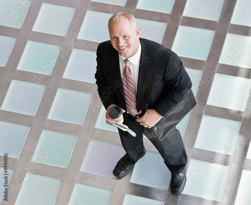 Businessman with briefcase and coffee in the morning