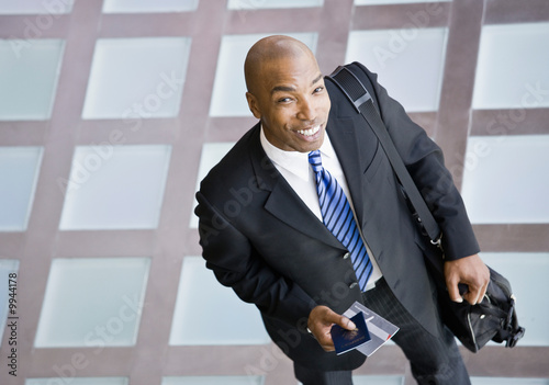 Businessman with briefcase and passport traveling
