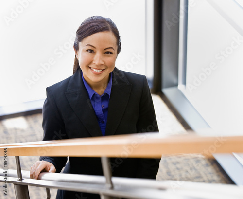 Asian businesswoman ascending stairs