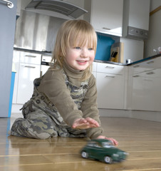 2 and half year old boy playing with a classic car