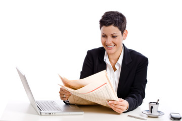 Businesswoman reading financial newspaper,