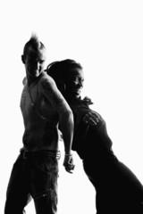 Man with Mohawk and Woman wearing Dreadlocks
