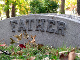 autumn cemetery grave headstone marked with father poster