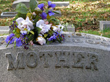 silk flowers on a cemetery grave headstone mother poster