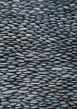 Wall of smooth pebbles. poster