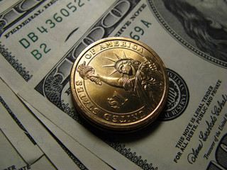 Hundred dollar denominations and coin of one dollar