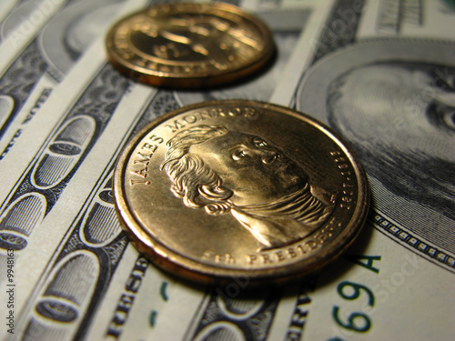 Hundred dollar denominations and two coins of one dollar