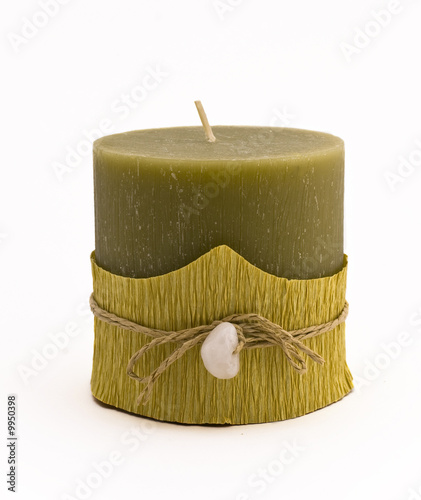 Green candle with stone close-up isolated