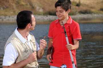 Father with son and free time, operation fishing.