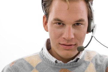 Smiling male customer service operator in headset,