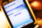 Sms message on mobile phone close-up. Love concept. poster