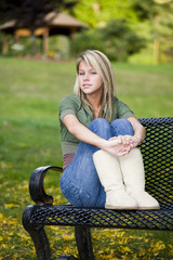 A beautiful blond teenage girl in the park