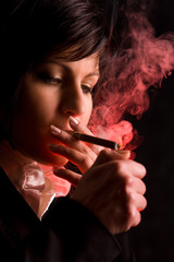 nice young girl is smoking in studio