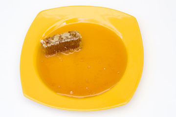 Natural Honey and Honeycomb on Yellow Ceramic Plate