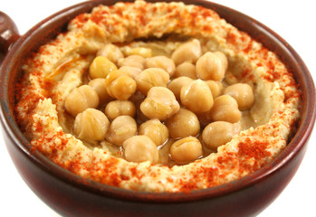 Earthenware bowl with delicious hommus and chickpeas