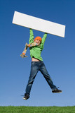 kid jumping with blank notice board poster