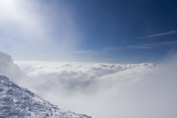 From the mountain peak. Winter weather - cluds and fog