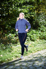 A female runner outdoors in a countryside setting