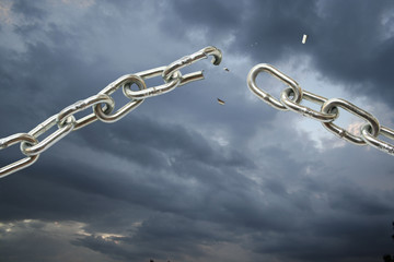 Broken chain on cloudy sky.