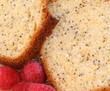 Macro image of lemon poppy seed pound cake and berries
