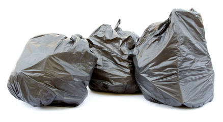 Three black garbage bags isolated on a white background