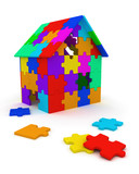 House built out of colorful puzzle pieces poster