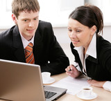 Portrait of two businesspeople working together poster