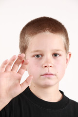 Young boy is preparing to say good bye. On white background