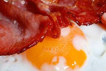 bacon rasher and fried egg , macro shot, shallow DOF