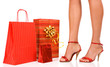 Attractive legs with colorful shopping bag.