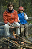 Mother and daughter near campfire poster