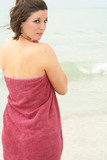 brunette covering herself with a towel poster