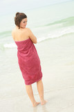 brunette covering herself with a towel vertical poster