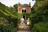 visitors/ couple walking towards decorative entrance. poster