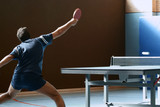 table tennis player returning the ball poster