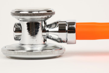 Detail of chrome and orange auscultoscope