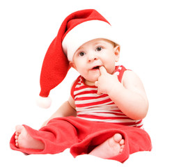 Surprised baby boy in santa claus hat on white background