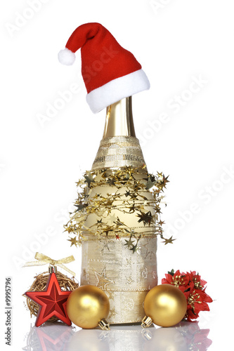 Christmas decoration and champagne bottle. Shallow DOF