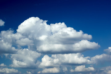dark blue sky is covered white clouds