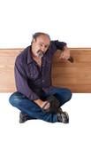 Drunk man leans on a wooden divider poster