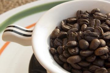 Coffee beans in tea-cup