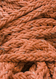 Orange rope background with coils of rope. poster