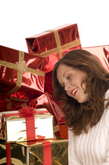 Beautiful model with golden Christmas gifts