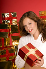 Beautiful brunette offering a Christmas gift