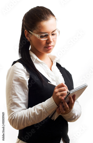 Young businesswoman with notepad.