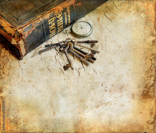 Leinwanddruck Bild Vintage Bible with pocketwatch and keys grunge background